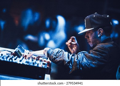 MOSCOW - 7 MARCH, 2015 : Famous hip hop producer Abraham Orellana aka Araabmuzik playing live music show on Akai MPC drum machine.Concert on stage of night club.DJ set of rap composer