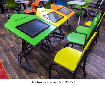 Moscow, 7 March 2017:Classroom computer.Interactive Class room table display and chairs in the hall Interactive technology.Classroom computer training Interactive display. Interactive display board