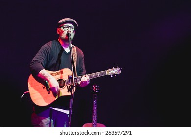 MOSCOW - 7 November,2014 : Rapper Everlast(House of Pain frontman)sing live on stage and play guitar in night club.Acoustic concert of famous rap,hip hop singer.Blues performer playing live music show
