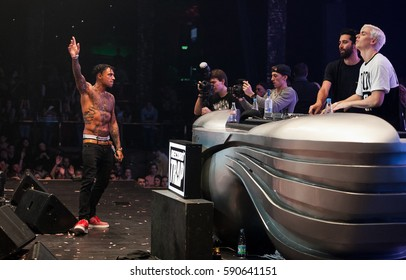MOSCOW - 8 FEBRUARY,2015: Concert of popular edm,trap band Yellow Claw on stage of night club.Electronic music party in nightclub.Adult entertainment event.Rap singer if front of big concert audience