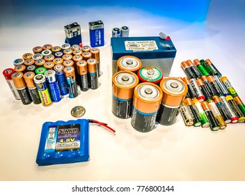 Moscow, 9 December 2017: Closeup of pile of used alkaline batteries. Used Rechargeable AA and AAA batteries in several colors, selective focus. Rechargeable Source of energy concept. Battery power