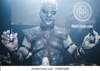MOSCOW - 9 DECEMBER,2016: International Vape Expo.Cosplay actors work at exposition advertising vaper liquid and vaping devices on sale.Man in fantastic White Walker costume from Game of Thrones