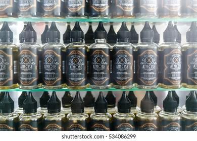 MOSCOW - 9 DECEMBER,2016: Vape store.Electronic cigarette filling shop.E-liquid,e-juice on sale in plastic bottle container.Eliquid,ejuice for vaping device gadget,fill vaporizer.Vape shop.No nicotine