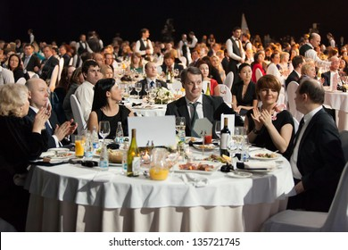 MOSCOW - APR 12: People sitting at the tables during Ceremony of rewarding of winners of an award Brand of year of EFFIE 2011, on April 12, 2012 in Moscow, Russia