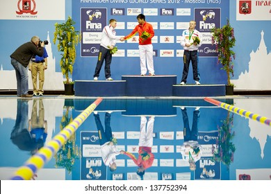 MOSCOW - APR 13: Athletes of Russia and China stand on victory podium during awarding at Pool of SC Olympic on day of third phase of the World Series of FINA Diving, April 13, 2012, Moscow, Russia.
