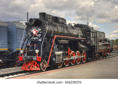 MOSCOW, APR, 15, 2005: Old retro steam locomotive of black and red colors on Rizhskiy railway station. Vintage USSR period steam loco with tender. Famous Russian locomotives trains railway vehicles
