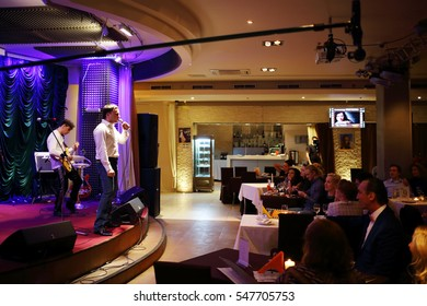 MOSCOW - APR 16, 2016: Yugorsky Alexander sings and people listen his in jazz club Kino, camera on crane