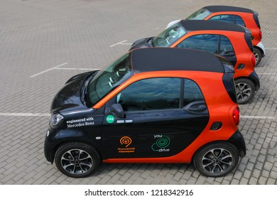 MOSCOW - APR 30, 2018: Three Mercedes Benz Smart cars of Moscow carsharing company You drive at parking, carsharing is system of short-term car rental, top view