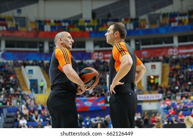 MOSCOW - APR 7, 2017: Two referees talk before basketball game Euroleague CSKA Moscow (Russia) - Olympiakos (Greece) in Megasport stadium