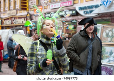 """MOSCOW - APRIL 10: Unidentified people having fun on the holiday of spring and bubbles """"Dreamflash"""" on April 10, 2011 on the famous pedestrian Arbat Street in Moscow"""