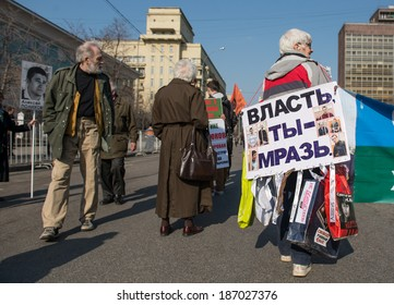 "MOSCOW - APRIL 13, 2014: Opposition meeting in protection of freedom of mass media ""March of truth"". Elderly woman with the poster on her back. Text: ""Power, you are rubbish!"""