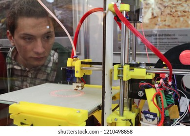 Moscow - April 15, 2016: A man looks at how a 3D printer works at the international exhibition of the fashion industry, Collection Premiere Moscow CPM. Public-event.