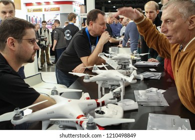 Moscow - April 15, 2016: Men discuss new drone model at the international exhibition of the fashion industry, Collection Premiere Moscow CPM. Public-event.