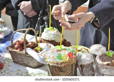 MOSCOW - APRIL 15, 2017: Baskets containing a sampling of Easter foods on the table at church yard, to be blessed on Holy Saturday.