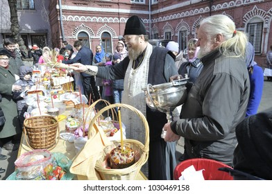 MOSCOW - APRIL 15, 2017: Easter ceremony on church yard - consecration of Easter cakes, eggs and other dishes.