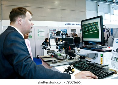 MOSCOW - APRIL 19: Demonstration the robot for PCB at the international exhibition of  electronic industry ExpoElectronica, ElectronTechExpo, LEDTechExpo on April 19, 2011 in Moscow