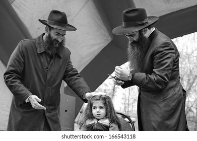 MOSCOW - APRIL 28: men prepare to finally cut the boy's hair on his third birthday during Lag ba-'Omer, a minor Jewish observance, on April 28, 2013 in Moscow.