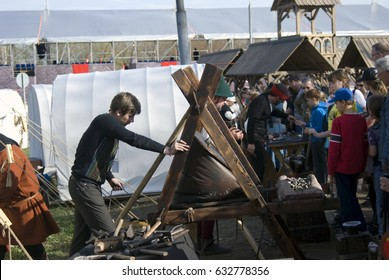 MOSCOW - APRIL 29, 2017: Reenactors show their skills in Kolomenskoye park in Moscow, Russia, popular touristic landmark. Color photo.