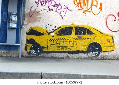 MOSCOW - APRIL 29: Graffiti on the wall, painted yellow taxi car, crashed into a telephone booth on April 29, 2012 in Moscow