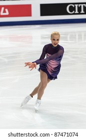 """MOSCOW - APRIL 30: Kiira Korpi competes in the single ladies free figure skating event at the 2011 World championship on April 30, 2011 at the Palace of sports """"Megasport"""" in Moscow, Russia."""