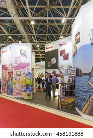 MOSCOW, April 3,2014: Business people look wallpapers for home German company Komar at the International Trade Fair Mosbuild