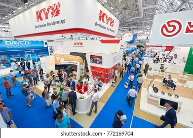 MOSCOW, AUG. 22, 2017: View on exhibition stands of car parts components details different companies. Car trucks tractors parts components details exhibition. Exhibition stands visitors people
