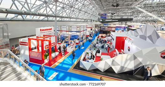 MOSCOW, AUG. 22, 2017: View on exhibition stands of car parts components details. Car trucks tractors parts components details on exhibition. Red white stands visitors people. Booth design