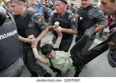MOSCOW - AUG 31: Policemen detain a participant of a rally in support for freedom of gathering in downtown Moscow August 31, 2011, Russia.