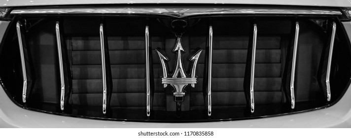 MOSCOW, AUG.31, 2018: Close up view on luxury car logotype of Maserati Levante radiator. Logos of world famous Italian automobiles. Automotive industry