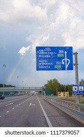 MOSCOW – AUGUAST 19, 2010: View on rainbow over vanishing Kievskoe Shosse Street with traffic on August 19, 2010 in Moscow.