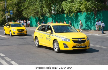MOSCOW - AUGUST 03: Two yellow taxi car in Zhukov Street on August 3, 2014 in Moscow.