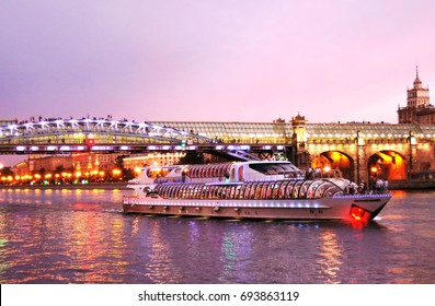 MOSCOW - AUGUST 07, 2017: Cruise ship sails on the Moscow river in Moscow city center, popular place for walking. Color evening photo.