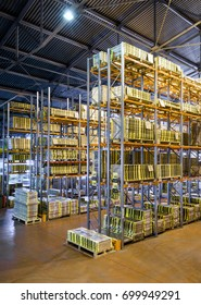 Moscow - August 1, 2017: The large warehouse interior. Logistics and transportation concept. Inside the modern warehouse. Industrial storage and stock. High warehouse racks.