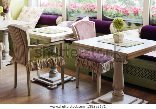 MOSCOW - AUGUST 1: Tables near windows in cafe Anderson near Sokol metro station, on August 1, 2012 in Moscow, Russia. Cafe is named after baker Anderson, who inspired Astrid Lindgren writing Carlson.