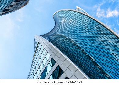 MOSCOW - AUGUST 10, 2016: Bottom view of Moscow-City skyscrapers. Moscow-City is an office buildings with futuristic design. Architecture landmark of Moscow. Amazing modern constructions against sky.