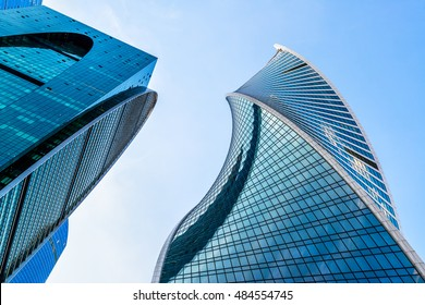MOSCOW - AUGUST 10, 2016: Low angle view of Moscow-City skyscrapers, Russia. Moscow-City is a new business district in Moscow centre. Tops of modern corporate buildings against the blue sky.