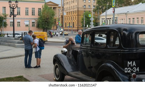 "Moscow, August 10, 2018, Boulevard ring.  ""Times and epochs"" festival of historical reconstruction. Soviet militia car 1930-1950s, in front of Petrovka 38 (criminal police) headquarters building."