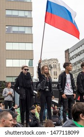 Moscow, August 10 2019. Protester with a Russian flag Meeting united more than 60 000 people being the biggest meeting since 2012 organized by opposition.