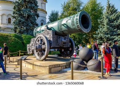 Moscow - August 15, 2018: Tourists are photographed near the Tsar Cannon (King Cannon) in Moscow Kremlin in winter. UNESCO World Heritage Site.