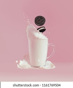 Moscow, August 17, 2018: Oreo falling in milk with splashes, pink background