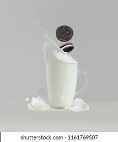 Moscow, August 17, 2018: Oreo falling in milk with splashes, grey background