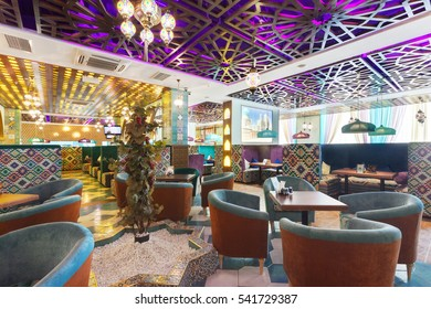 """MOSCOW - AUGUST 2014: Interior Asian restaurant """"Chayhana Izum"""". The main dining room is decorated in oriental style"""