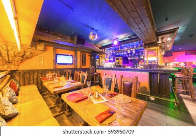"""MOSCOW - AUGUST 2014: Interior of the Mexican nightclub restaurant """"SOMBRERO"""". Wooden table near the bar counter"""
