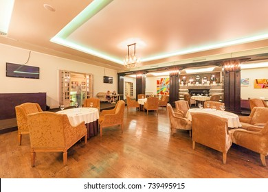 """MOSCOW - AUGUST 2014: Interior of the restaurant of Georgian and European cuisine - """"ARCHITECT"""". The main room of the restaurant"""