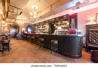 "MOSCOW - AUGUST 2014: Interior of a small ""Klava"" bar. Large black wooden bar counter in classic style"