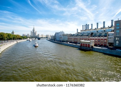 MOSCOW – AUGUST, 2018: View from new floating bridge of Zaryadye Park on Embankment of Moscow river with The Moscow Orphanage,  Skyscraper on Kotelnicheskaya quay and HPP - 1 named after Smidovich