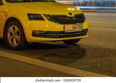 MOSCOW - August, 2019: Yellow car is parked with hidden number. Closeup evening photo.