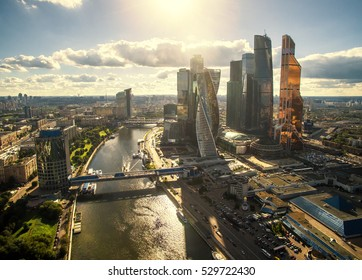 MOSCOW - AUGUST 25, 2016: Aerial panoramic view of Moscow-City, Russia. Beautiful panorama of Moscow with the modern office buildings of Moscow-City in the sun light. Moscow skyline with Moskva River.