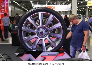 Moscow - August 26, 2016: The man is inspecting a new innovative wheel at the Moscow International Automobile Salon, MIAS. Public-event.