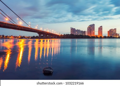 Moscow bridge over stunning sunset in Kiev, Ukraine. Kiev city skyline.